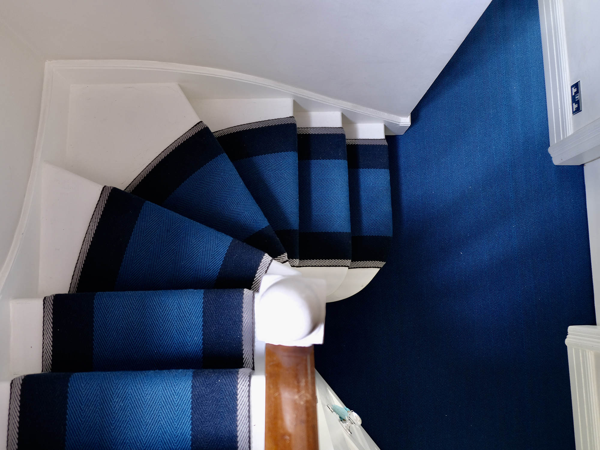 Franklin Indigo fitted on 3 winding steps over a 90 degree turn and custom ground hand seamed in hallway