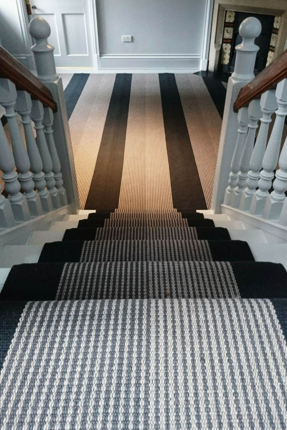 Troy Charcoal fitted on stairs and hand seamed to create a large area rug