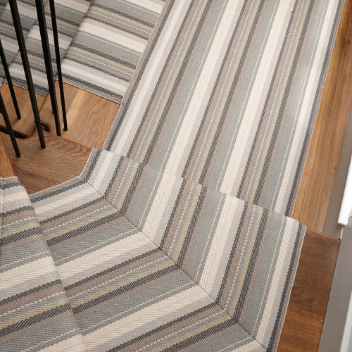 Isis Reed mitred on a large winding step and overlaid on landing